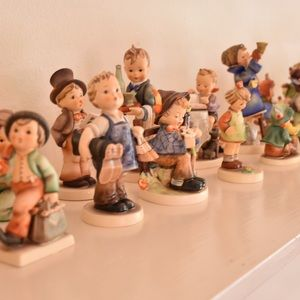 authentic hummel collection. 26 figurines total.
